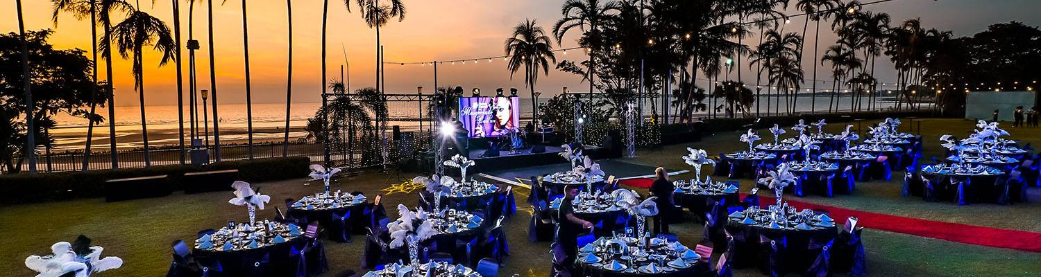 Outdoor event set-up with tables and stage | Beachside Events | Darwin, Australia