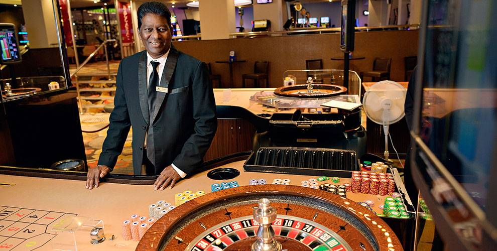 Casino Dealer with Roulette Wheel | Mindil Beach Casino & Resort