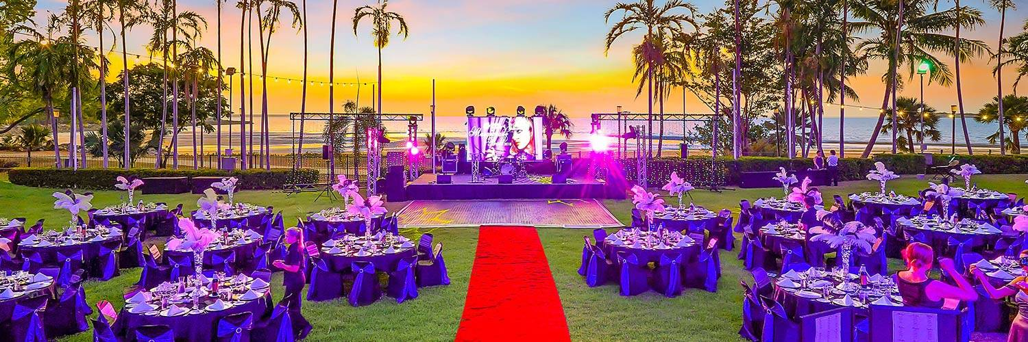 Outdoor event set-up with tables and stage | Oceanside Events | Darwin, Australia